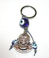 Gelukssleutelhanger Boedha met blauwe glazen 'boze oog' kralen